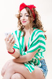 Pretty funny pinup woman speaking on mobile phone Royalty Free Stock Photos