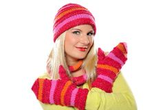 Pretty funny winter woman in hat and gloves Stock Photos
