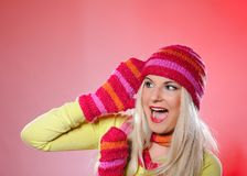 Pretty funny winter woman in hat and gloves scream Royalty Free Stock Photo
