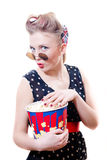 Pretty funny young blond elegant pinup woman with curlers round glasses. Elegant pinup woman with curlers round glasses having fun eating popcorn & looking at Stock Images