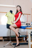 Pretty funny young pinup woman with mannequin Royalty Free Stock Photography