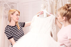 Pretty future bride is choosing clothing for event Stock Photography
