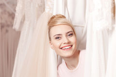 Pretty future bride is making fun in boutique Royalty Free Stock Photography