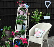Pretty garden area. A pretty garden area with chair and ladder royalty free stock photography