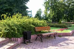 Calm garden bench sunny day royalty free stock photo