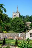 Pretty garden and church tower, Castle Combe. Stock Image