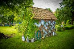 Pretty garden house in a dreamlike idyll. A pretty garden house in a dreamlike idyll stock photography