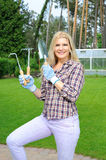 Pretty gardener woman with gardening tools Stock Photos
