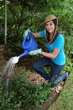 Pretty Gardening Lady Stock Photo
