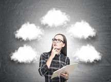 Pretty geek girl in glasses, thought clouds Stock Photography