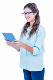 Pretty geeky hipster holding tablet Royalty Free Stock Photos