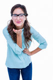 Pretty geeky hipster sending kiss to camera Stock Photos