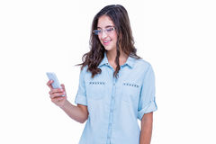 Pretty geeky hipster using her smartphone Stock Photography