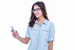 Pretty geeky hipster using her smartphone Royalty Free Stock Photos