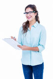 Pretty geeky hipster writing on notebook and smiling at camera Stock Photography