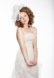 Pretty gentle happy girl in bridal dress. Stock Photos