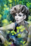 Pretty gentle young fashion woman in field royalty free stock images