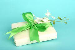 Pretty gift. Sweet gift with flower arrangement; feminine; spring or summer colored stock image
