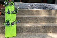 Pretty gift bags with flowers on cement steps Stock Photos