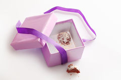 Pretty gift box with last chocolate truffle Royalty Free Stock Images