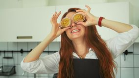 Pretty Ginger Woman Having Fun at Domestic Kitchen. Redhead girl. Pretty Ginger Woman Having Fun at Domestic Kitchen. Smiling Girl Covering Eyes with Cinnamon stock video