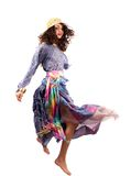 Pretty gipsy lady in retro colorful dress dancing Stock Photography
