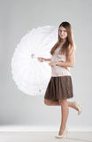 Pretty girl. Girl standing with white umbrella stock images
