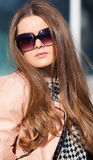 Pretty girl. In sunglasses close-up royalty free stock photos