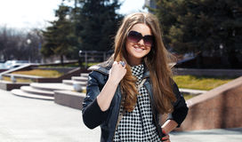 Pretty girl. In sunglasses walks stock photography