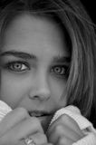 Pretty girl-2. Gorgeous teen girl in black and white shot looks into camera with beautiful green eyes royalty free stock photo