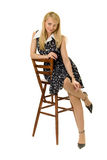 Pretty girl. Pretty girl sitting on high wooden chair Stock Photo
