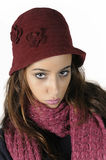 Pretty girl. Close-up of a serious girl with red wool cap stock image