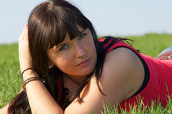 Pretty girl. In the green grass Royalty Free Stock Photos