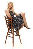 Pretty girl. Pretty girl sitting on high wooden chair Royalty Free Stock Images