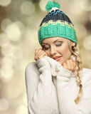 Pretty girl in act to warm Royalty Free Stock Photos