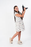 Pretty girl with african braids aiming Stock Photography