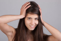 Pretty girl with ands at her head Stock Photo