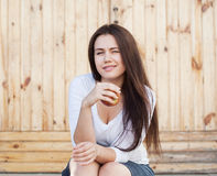 Pretty girl with apple Royalty Free Stock Images