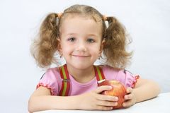 The pretty girl with an apple. Portrait of the pretty girl with an apple, over white Stock Photography
