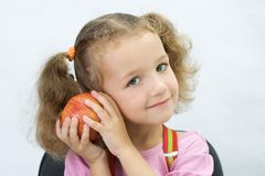 The pretty girl with an apple Stock Images