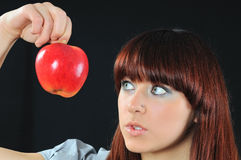 Pretty girl with apple Royalty Free Stock Image