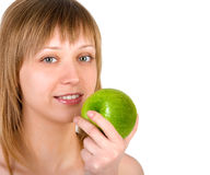 Pretty girl with apple Stock Image