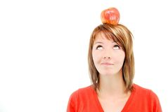 Pretty girl with apple on head Royalty Free Stock Photos