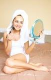 Pretty Girl Applying Makeup Stock Images