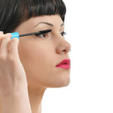 pretty girl applying mascara Stock Photo
