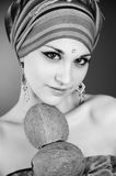 Pretty girl in arabic style with coconuts. Portrait shot Royalty Free Stock Image