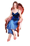 Pretty girl in armchair. Royalty Free Stock Photo