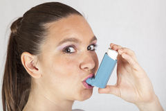 Pretty girl with asthma inhaler Royalty Free Stock Photo