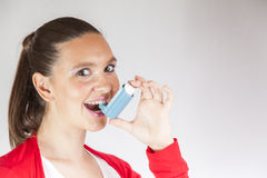 Pretty girl with asthma inhaler Royalty Free Stock Images