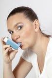 Pretty girl with asthma inhaler Stock Photos